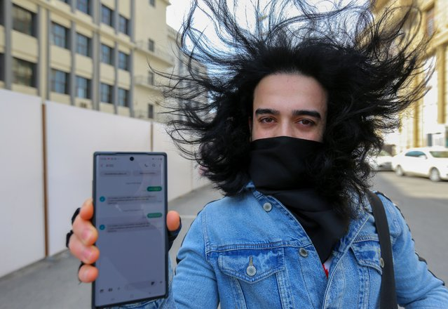 A man shows his mobile phone with permission to leave home, received in a text message, after the authorities imposed restrictions on movement to prevent the spread of the coronavirus disease (COVID-19) in Baku, Azerbaijan April 6, 2020. According to the new restrictions, citizens have to obtain permission by sending a text message in order to leave home for essential trips, including visits to grocery stores, pharmacies, medical facilities, banks or post offices, or to attend funerals. (Photo by Aziz Karimov/Reuters)