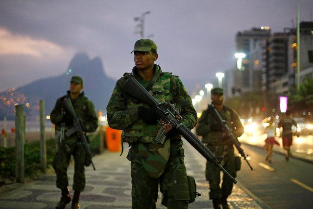 Brazilian soldiers patrol along Ipanema Beach ahead of the Rio 2016 Olympic Games in Rio de Janeiro, July 25, 2016. (Photo by Ivan Alvarado/Reuters)
