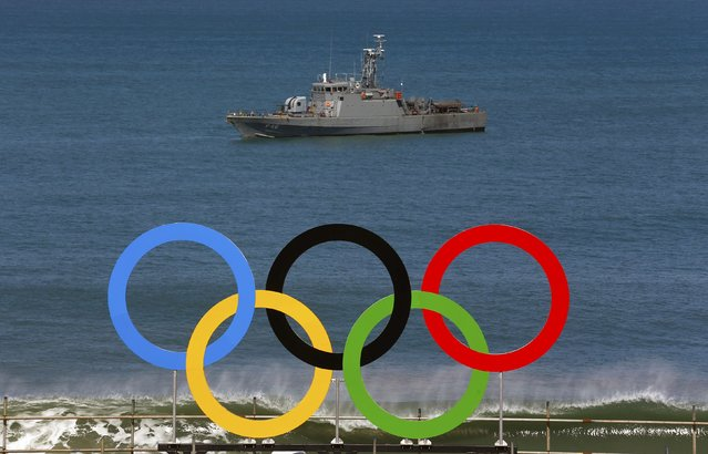 A military ship is seen near the Olympic rings at Copacabana beach in Rio de Janeiro, Brazil August 1, 2016. (Photo by Nacho Doce/Reuters)