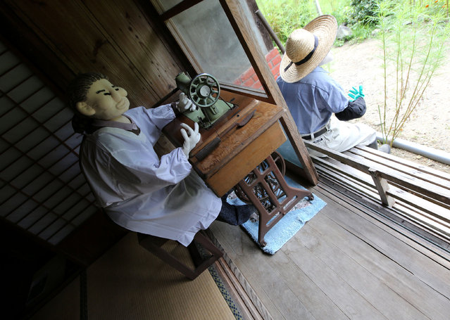 An illustration showing scarecrows sitting in an abandoned 80 year old house is on display at Kakashi no Sato, or the Scarecrow's Hometown on September 10, 2014 in Himeji, Japan. (Photo by Buddhika Weerasinghe/Getty Images)