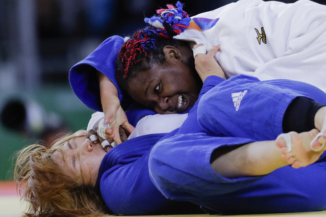 Cuba's Idalys Ortiz, white, competes against South Korea's Kim Min-jeong during the women's over 78-kg judo competition at the 2016 Summer Olympics in Rio de Janeiro, Brazil, Friday, August 12, 2016. (Photo by Markus Schreiber/AP Photo)