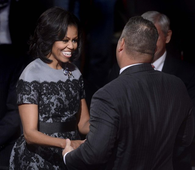 First lady Michelle Obama is greeted before the start of the debate. (Photo by Michael Reynolds/Associated Press)