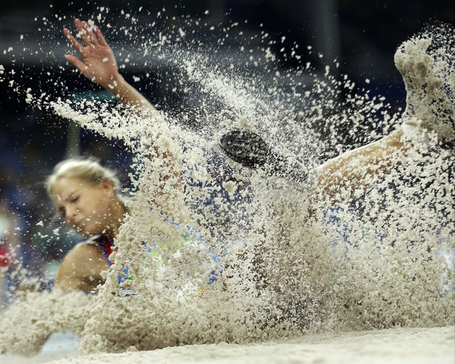 Russia's Darya Klishina makes an attempt in the women's long jump qualification during the athletics competitions of the 2016 Summer Olympics at the Olympic stadium in Rio de Janeiro, Brazil, Tuesday, August 16, 2016. (Photo by Matt Slocum/AP Photo)