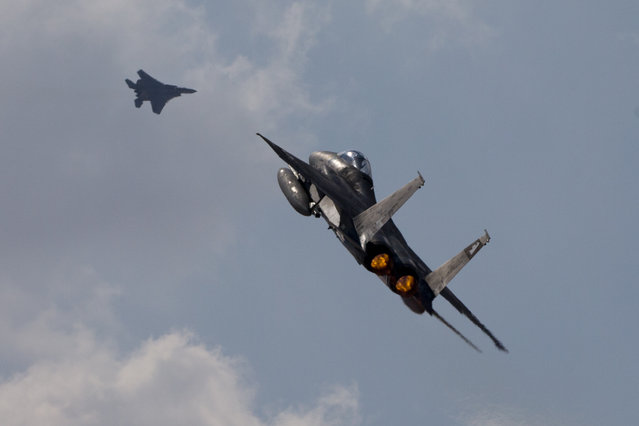 """In this Wednesday, November 8, 2017 photo Two Israeli air force F-15s of the Knights of the twin tail 133 squadron fly over Ovda airbase near Eilat, southern Israel, during the 2017 Blue Flag exercise. Israel's military is holding the largest ever air drill of its kind with pilots from eight countries simulating combat scenarios. It said Thursday that Germany, India and France are taking part for the first time in the two week drill codenamed """"blue flag"""", held every two years. (Photo by Ariel Schalit/AP Photo)"""