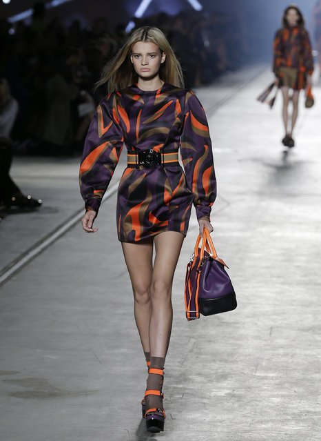 A model wears a creation for Versace women's Spring-Summer 2016 collection, part of the Milan Fashion Week, unveiled in Milan, Italy, Friday, September 25, 2015. (Photo by Antonio Calanni/AP Photo)