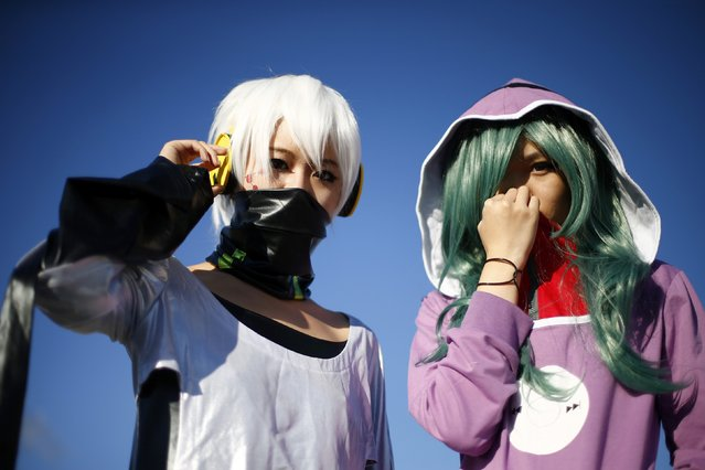 "Attendees pose as ""Konoha"" and ""Kido"" (R) outside the MCM Comic Con at the Excel Centre in East London, October 25, 2014. (Photo by Andrew Winning/Reuters)"