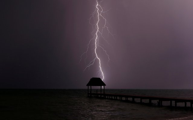 Lightning strikes the Caribbean as a thunderstorm passes Tankah Bay, near Tulum, southern Mexico, August 31, 2017. (Photo by Andrew Winning/Reuters)
