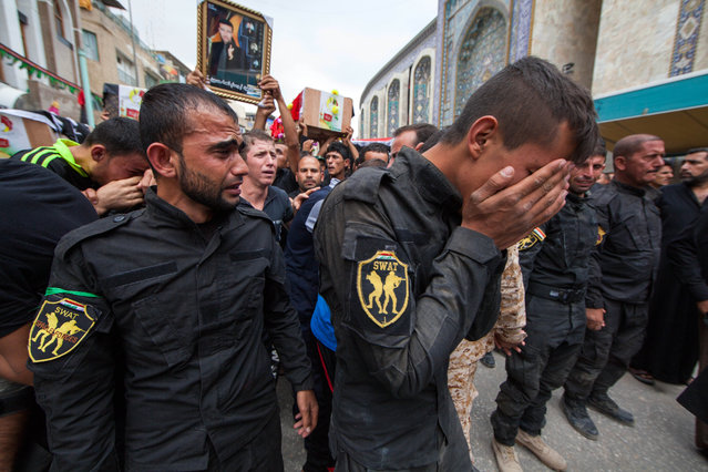 Members of Iraq's Special Weapons and Tactics Team (SWAT) mourn during the funeral procession their colleagues in the Shiite holy city of Karbala, 50 miles (80 kilometers) south of Baghdad, Iraq, Monday, October 27, 2014. A suicide car bomber driving a military Humvee struck a checkpoint manned by the SWAT unit and Shiite militiamen in the Sunni town of Jurf al-Sakhar south of Baghdad on Monday, killing at least 24 people, officials said. (Photo by Ahmed al-Husseini/AP Photo)