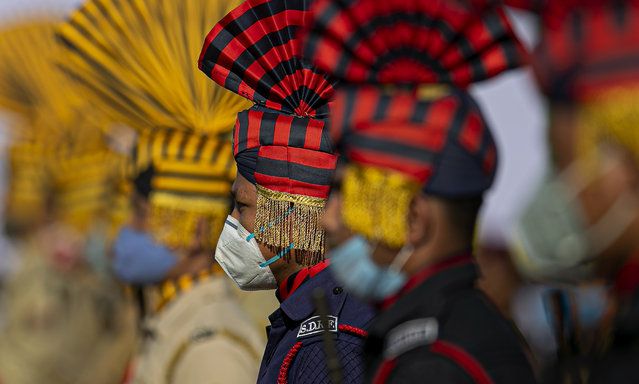 Indian paramilitary soldiers wearing face masks participate in the final dress rehearsals of India's Independence Day ceremony in Gauhati, India, Thursday, August 13, 2020. (Photo by Anupam Nath/AP Photo)