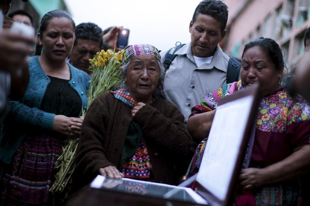 Relatives participate in the burial of Santos Etelvina Sontay, a victim of a mudslide in Santa Catarina Pinula, on the outskirts of Guatemala City, October 5, 2015. (Photo by Jose Cabezas/Reuters)