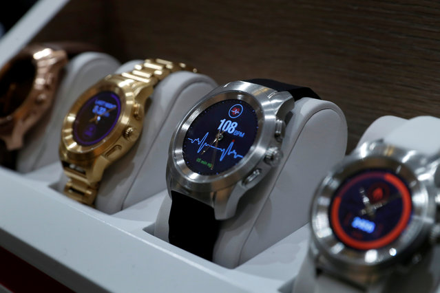 ZeTime smartwatches by MyKronoz of Switzerland, the world's first hybrid smartwatch combining mechanical hands with a color touchscreen, are displayed during Pepcom's Digital Experience in Las Vegas, Nevada, U.S. January 9, 2018. (Photo by Steve Marcus/Reuters)