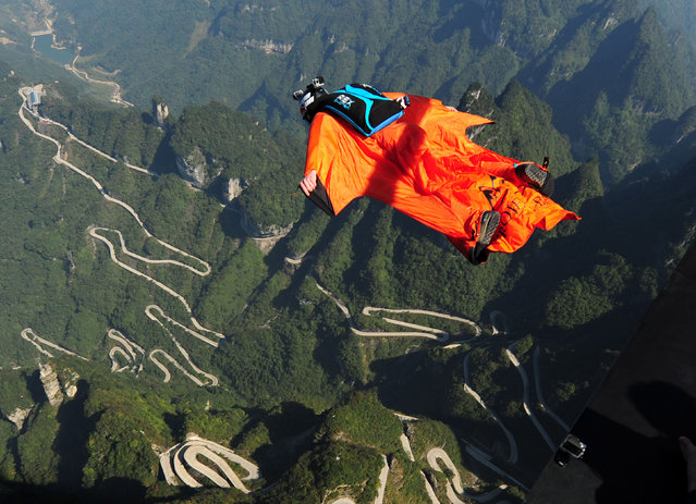 A participant in wingsuit flies above Tianmen Mountain at Zhangjiajie Scenic Spot during the 4th Red Bull WWL China Grand Prix on October 16, 2015 in Zhangjiajie, Hunan Province of China. The 4th Red Bull WWL China Grand Prix will last three days from October 16-18 in Zhangjiajie. (Photo by ChinaFotoPress/Getty Images)