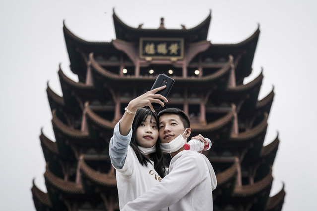 Tourists take a selfie in Yellow Crane Tower Park on October 7, 2020 in Wuhan, Hubei province, China. China is celebrating its national day from October 1 to 8, marking the 71st anniversary of the founding of the People's Republic of China.  As there have been no recorded cases of community transmission in Wuhan since May, life for residents is gradually returning to normal. (Photo by Getty Images/Stringer)