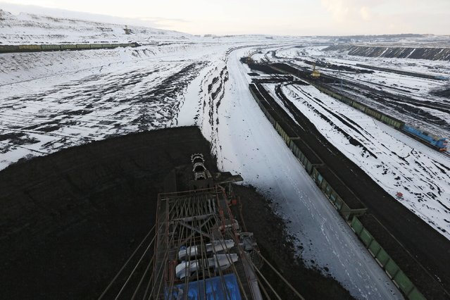 A coal face is seen from the top of a rotary dredge which loads wagons with coal at the Borodinsky opencast colliery, near the Siberian town of Borodino, east of Krasnoyarsk, October 27, 2015. (Photo by Ilya Naymushin/Reuters)