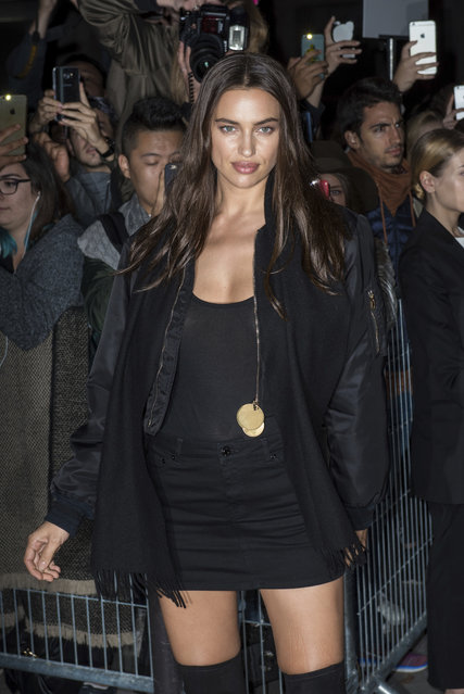 Model Irina Shayk poses for photographers on arrival for Givenchy's Spring-Summer 2017 ready-to-wear fashion collection presented in Paris, Sunday, October 2, 2016. (Photo by Zacharie Scheurer/AP Photo)