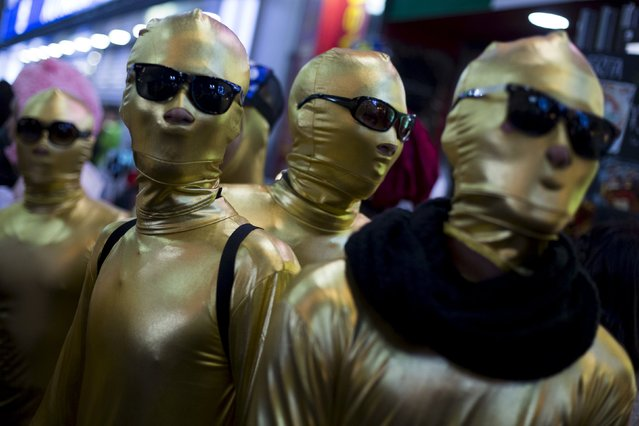 Revellers wearing morphsuits mingle during Halloween celebrations in the Shibuya district in Tokyo, Japan October 31, 2015. (Photo by Thomas Peter/Reuters)