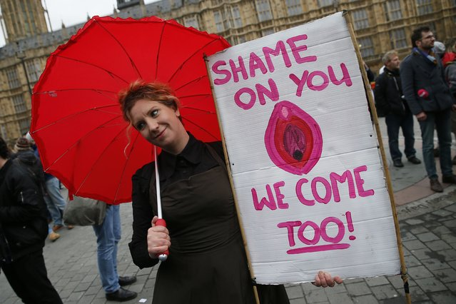 A protesters takes part in a demonstration against new laws on p*rnography outside parliament in central London December 12, 2014. (Photo by Stefan Wermuth/Reuters)
