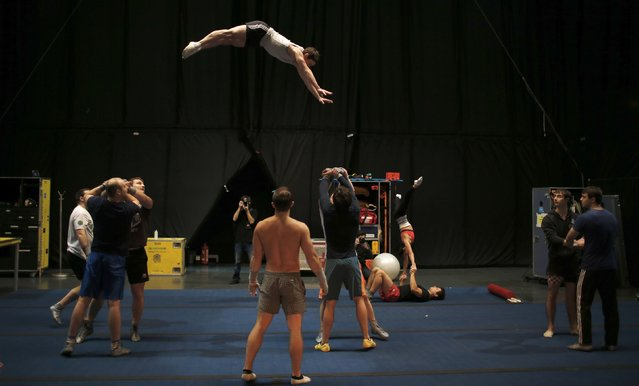 "Performers from Cirque du Soleil's show ""Quidam"" practice backstage before a show at the MEO Arena in Lisbon December 18, 2014. (Photo by Rafael Marchante/Reuters)"