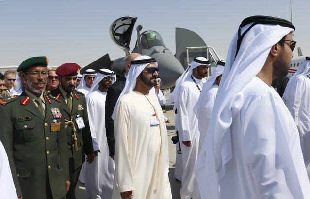 United Arab Emirates Vice President, Prime Minister and Dubai ruler Sheikh Mohammed bin Rashid al-Maktoum (C) tours the Dubai Airshow November 8, 2015. (Photo by Ahmed Jadallah/Reuters)
