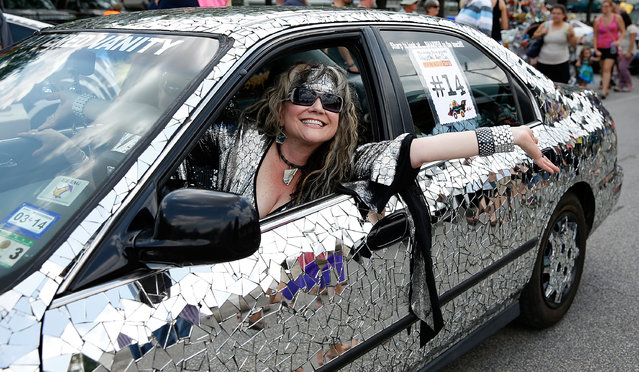 A paradegoer is seen on Allen Parkway during the 26th Annual Houston Art Car Parade on May 11, 2013 in Houston, Texas.  (Photo by Scott Halleran/Getty Images)