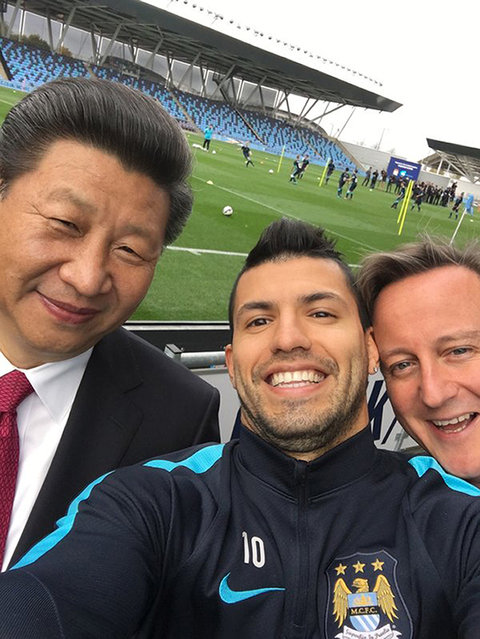 Handout photo issued Manchester City Football Club of the striker Sergio Aguero taking a selfie with Chinese President Xi Jinping and Prime Minister David Cameron as they visited the City Football Academy in Manchester on the last day of the state visit to the UK on Friday October 23, 2015.  (Photo by MCFC/PA Wire)