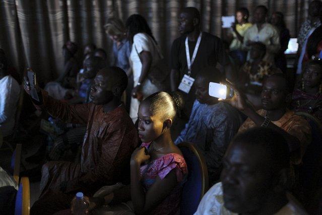 Guests watch the Festi'Bazin runway show in Bamako, Mali, October 16, 2015. (Photo by Joe Penney/Reuters)