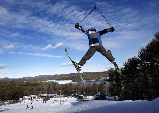 A skier catches some air at the Shawnee Peak ski resort, where man-made snow made for good holiday skiing, Monday, December 29, 2014, in Bridgton, Maine. Nearly all the early season snow in southern Maine was washed away with record-setting warmth and rain during Christmas week. (Photo by Robert F. Bukaty/AP Photo)