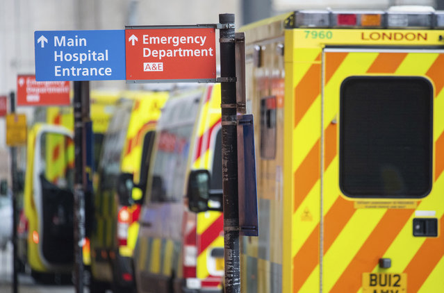Ambulances outside the Royal London Hospital, in London, Tuesday December 29, 2020.  England Health Service figures show hospitals now have more Covid-19 patients than during April's first-wave peak, with fears of increased figures because of a Christmas social spread. (Photo by Dominic Lipinski/PA Wire via AP Photo)