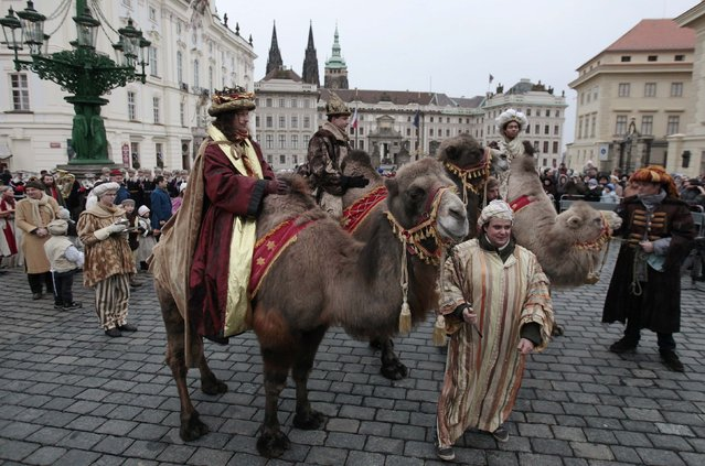 Men dressed as the Three Kings sit on camels during the Three Kings procession at Hradcanske Square, as part of a re-enactment of the Nativity scene, in Prague January 5, 2015. (Photo by David W. Cerny/Reuters)