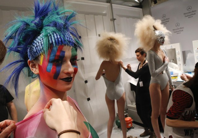 Models prepare backstage before presenting makeup creations during a show by Maybelline New York at the Berlin Fashion Week Autumn/Winter 2015 in Berlin January 19, 2015. (Photo by Fabrizio Bensch/Reuters)