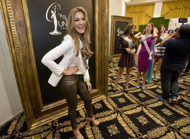 In this January 12, 2015, file photo, Miss Universe contestant Migbelis Lynette Castellanos, of Venezuela, laughs as she poses for photos after a news conference for contestants from Latin America and Spain, in Doral, Fla. (Photo by Wilfredo Lee/AP Photo)