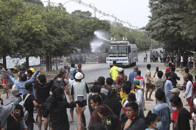 A police truck uses a water cannon to disperse protesters in Mandalay, Myanmar, on Saturday, February 20, 2021. (Photo by AP Photo/Stringer)