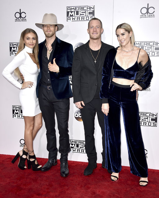 Brian Kelley, center left, and Tyler Hubbard, center right, of Florida Georgia Line, and from left, Brittney Marie Cole and Hayley Stommel arrive at the American Music Awards at the Microsoft Theater on Sunday, November 20, 2016, in Los Angeles. (Photo by Jordan Strauss/Invision/AP Photo)