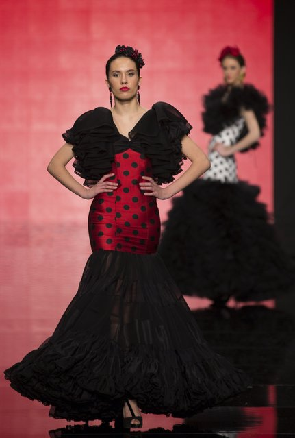 Models present creations by Maria Avila during the International Flamenco Fashion Show SIMOF in the Andalusian capital of Seville February 5, 2015. (Photo by Marcelo del Pozo/Reuters)