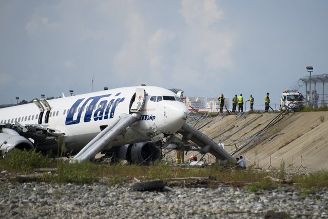 A view of the Utair-operated Boeing 737-800  which skidded off the runway and caught fire during landing, at Sochi international airport, of the Russian Black Sea resort of Sochi, Russia, Saturday, September 1, 2018. Russia's transportation minister says a supervisor at the airport in Sochi died during the emergency response after a landing airliner careered off the end of the runway, into a riverbed and caught fire. There were no deaths reported among the 164 passengers and six crew members aboard the Utair Boeing 737, but the Russian health ministry said 18 people were injured. The fire was extinguished within eight minutes, the airport said. (Photo by AP Photo/Stringer)