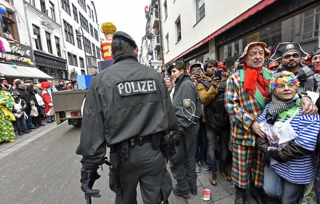Police secure the traditional carnival parade in Cologne, western Germany, Monday, February 16, 2015. (Photo by Martin Meissner/AP Photo)