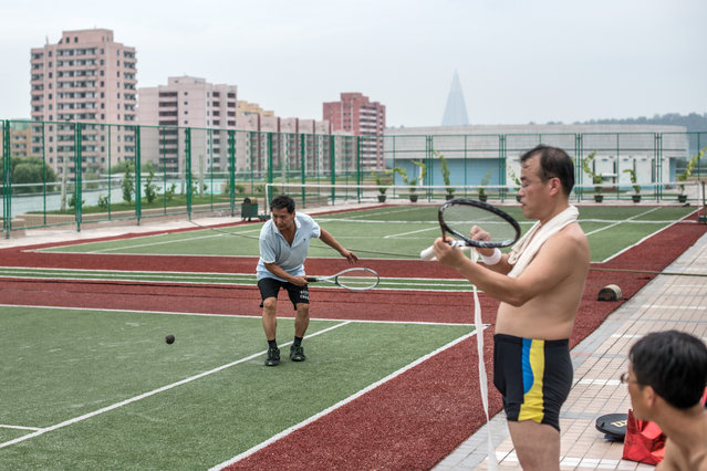 Men play tennis and relax at the Munsu Water Park complex on August 19, 2018 in Pyongyang, North Korea. (Photo by Carl Court/Getty Images)