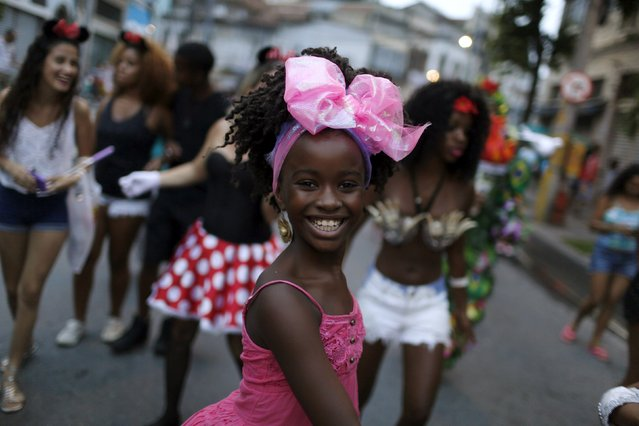 Revellers take part in an annual block party before Carnival in downtown Rio de Janeiro, Brazil, January 16, 2016. The Rio de Janeiro Carnival will be held from February 5 to February 9. (Photo by Pilar Olivares/Reuters)