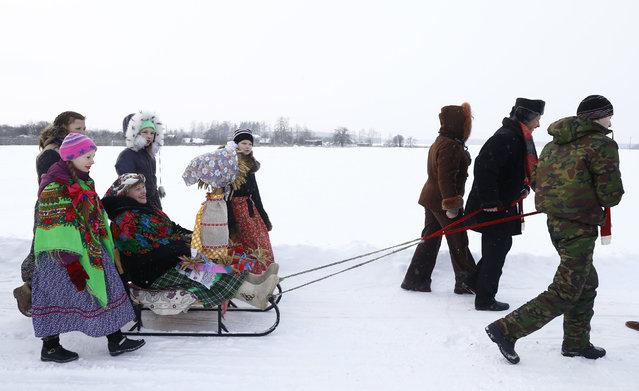 Villagers take part in Kolyada holiday celebrations in the village of Martsiyanauka, Belarus, January 21, 2016. (Photo by Vasily Fedosenko/Reuters)