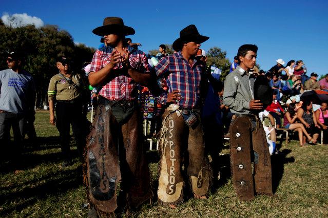 Bull riders prepare prior to a bull riding event in Santa Tecla, El Salvador, December 15, 2016. (Photo by Jose Cabezas/Reuters)