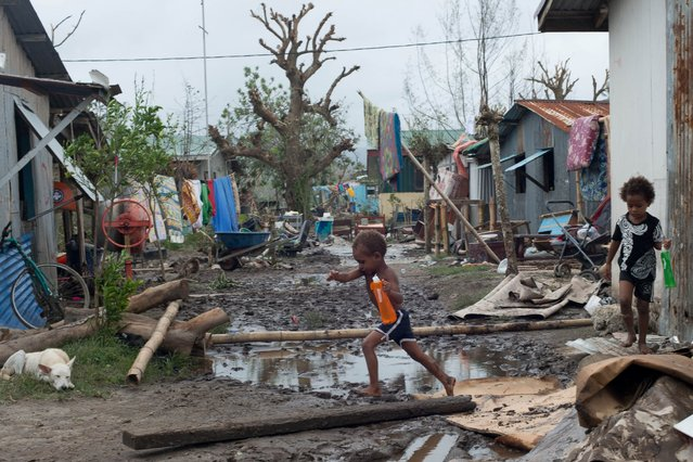 This handout image provided by UNICEF, shows residents contending with storm damage from Cyclone Pam in Mele village, March 15, 2015 in Port Vila, Vanuatu. (Photo by Getty Images/UNICEF)