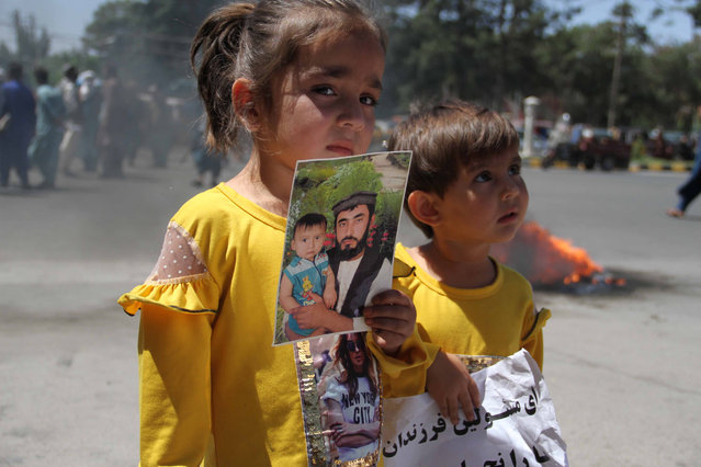 Relatives of the Afghan Army soldiers, who are trapped in Obde district of Herat while fighting against Taliban militants, protest to demand the government evacuate the injured soldiers, in Herat, Afghanistan, 17 June 2021. Afghan authorities said they are in the process to arrange the evacuation of Army soldiers from the restive district soon. There has been a particularly bloody spike in violence in the country in recent weeks, following the start of the withdrawal of US troops from the country, a process due to be complete by September 11. (Photo by Jalil Rezayee/EPA/EFE)