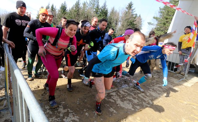 Participants start the Wild Sau Dirt Run 2015 in Obertriesting, Lower Austria, Austria, Saturday, April 4, 2015. (Photo by Ronald Zak/AP Photo)