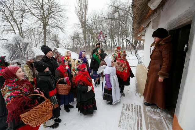 Children dressed in traditional costumes sing Christmas carols as they gather to celebrate Orthodox Christmas at a compound of the National Architecture museum in Kiev, Ukraine January 7, 2017. (Photo by Valentyn Ogirenko/Reuters)