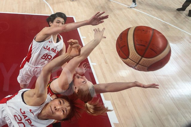 Japan's Nanako Todo (front) fights for the rebound during the women's quarter-final basketball match between Japan and Belgium during the Tokyo 2020 Olympic Games at the Saitama Super Arena in Saitama on August 4, 2021. (Photo by Gregory Shamus/Pool via AFP Photo)