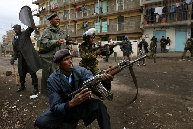 Kenyan policemen holding rifles confront demonstrators during clashes in the Mathare slums on January 20, 2008 in Nairobi, Kenya.  (Photo by Uriel Sinai/Getty Images)