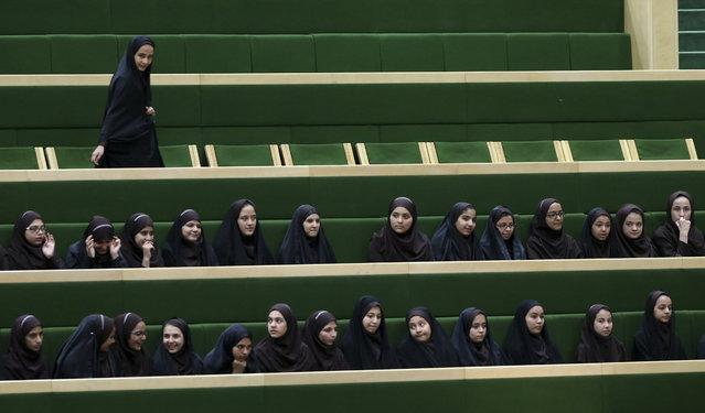 Iranian school girls follow the debates of the parliament, in Tehran, Iran, Tuesday, April 14, 2015. (Photo by Vahid Salemi/AP Photo)