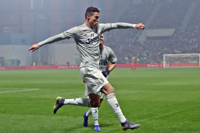 Juventus' Cristiano Ronaldo celebrates after scoring his side's second goal during series soccer match between Sassuolo and Juventus, at the Mapei Stadium in Reggio Emilia, Italy, Sunday, February 10, 2019. (Photo by Elisabetta Baracchi/ANSA via AP Photo)