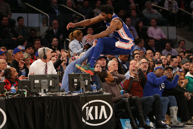 Philadelphia 76ers center Joel Embiid saves a ball from going out of bounds by jumping over actress Regina King during the third quarter against the New York Knicks at Madison Square Garden on February 14, 2019. (Photo by Brad Penner/USA TODAY Sports via Reuters)