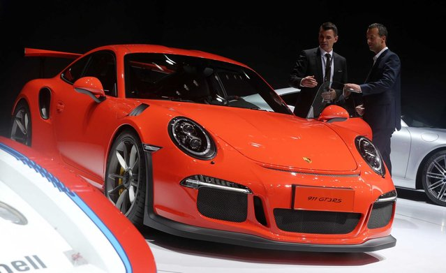 Visitors look at the Porsche 911 GT3 on display at the 16th Shanghai International Automobile Industry Exhibition in Shanghai, China, 20 April 2015. (Photo by How Hwee Young/EPA)